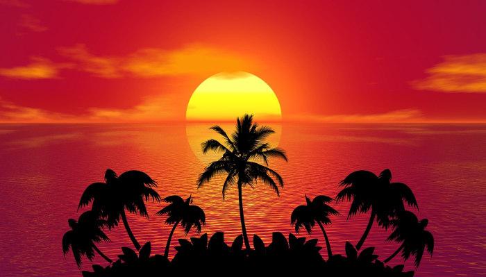 apus de soare pe o insula tropicala cu palmieri